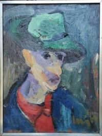 Muškarac sa zelenim šeširom